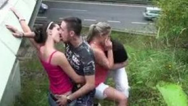 2 guys fuck 2 girls with one fat girl with very big tits by a highway bridge